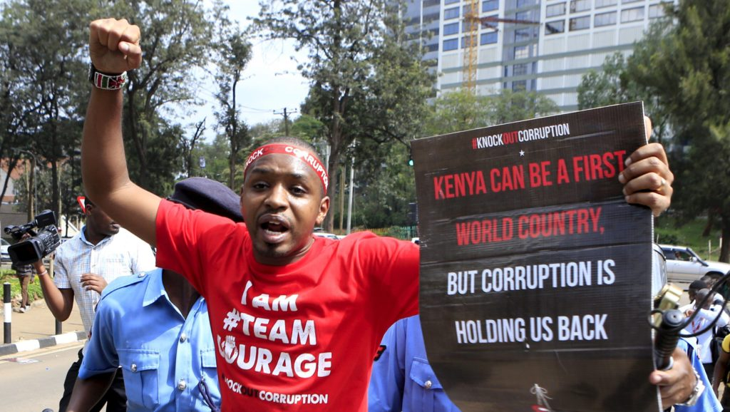 Boniface Mwangi takes his message to the streets in this photo by our mutual friend, Noor Khamis [via Reuters].